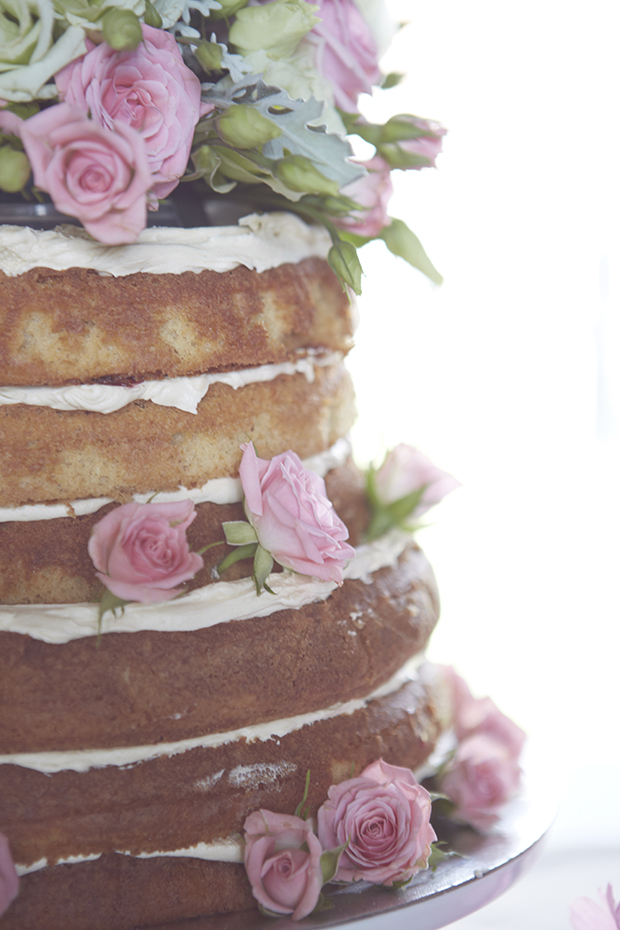 Naked caked with pink flowers details