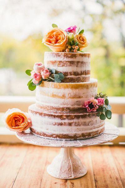 Naked cake with orange flowers