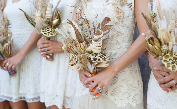 Feather and flower bouquets with bridesmaids