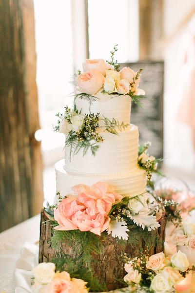 Ivory buttercream wedding cake with peach flowers