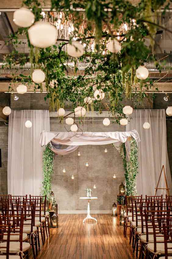 High Ceilings and greenery with lanterns hanging