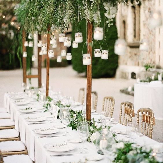 Wedding Decor with Greenery and White Candles