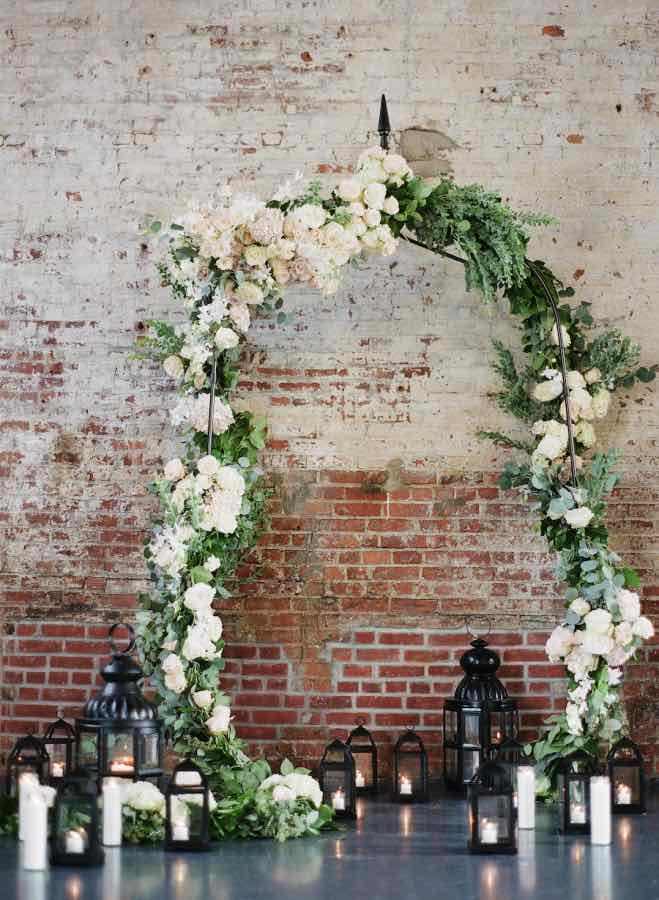 Brick and Wedding Arch with Flowers