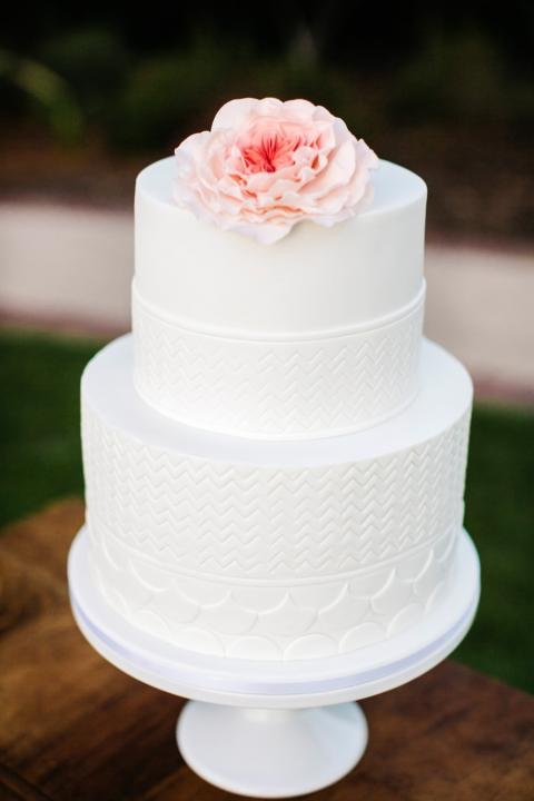 White Minimalist Wedding Cake with Texture and Flowers