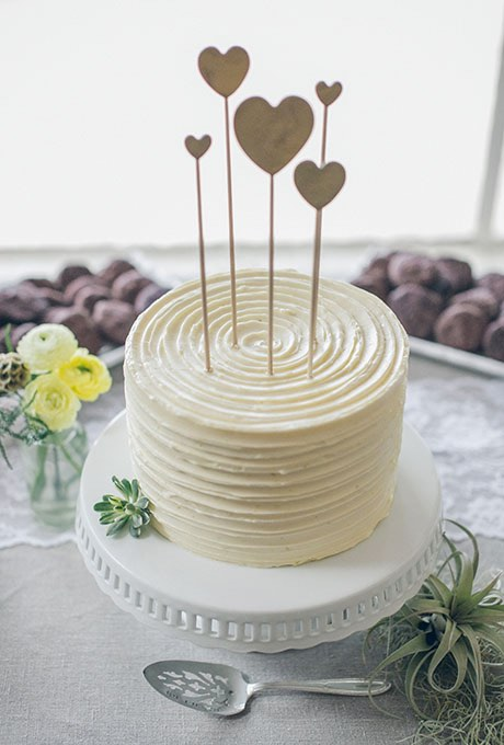 White Wedding Cake with Heart Topper