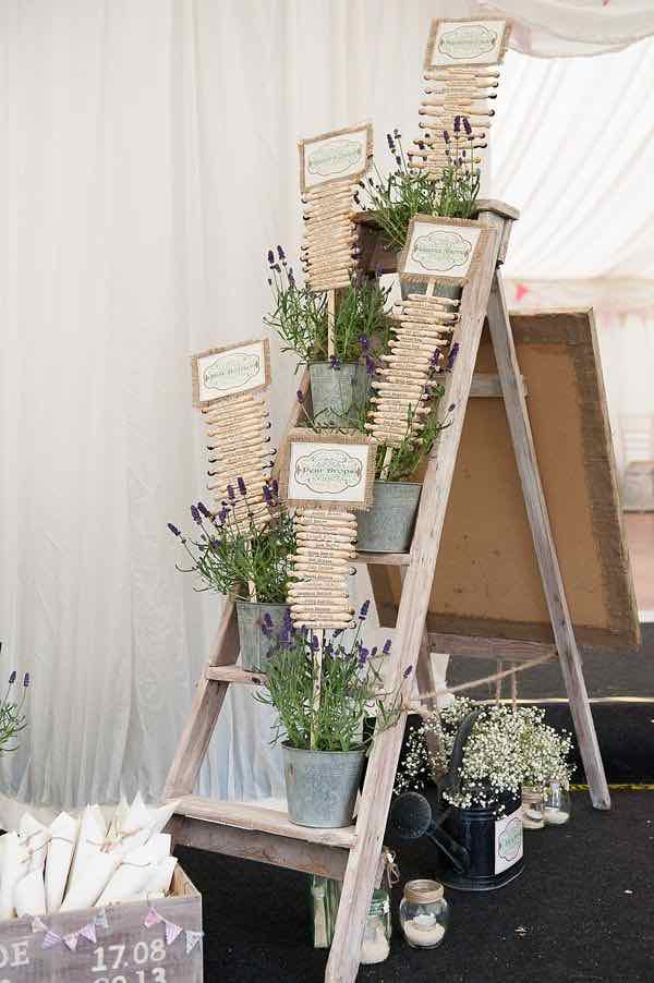 Wooden Pegs in Tins on Ladder as Table Plan