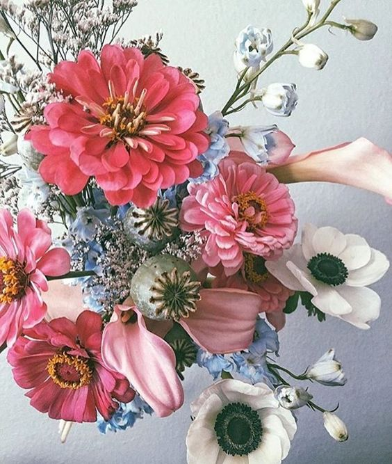 Pink, White and Blue Flowers in Wedding Bouquet