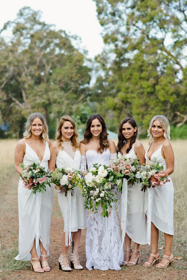 Bride and Bridesmaid in White Dresses