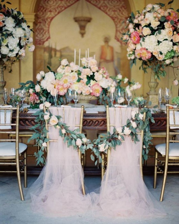 Sweetheart Table With Draping Fabric Chairs