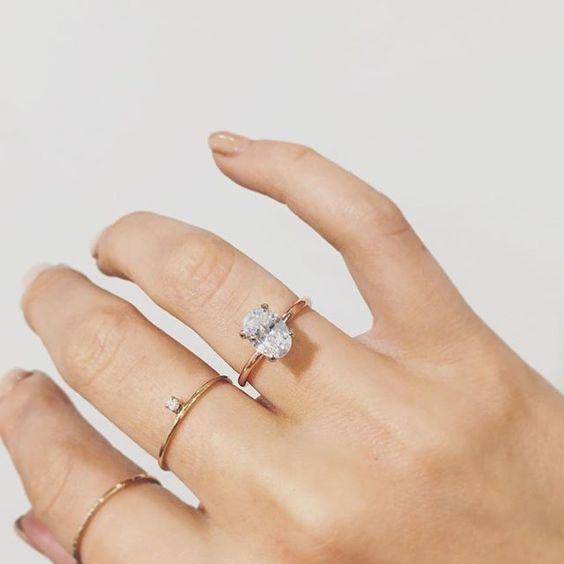 Oval Engagement Ring with Gold Details