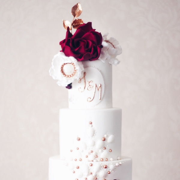 White Wedding Cake with Red and Gold Flowers