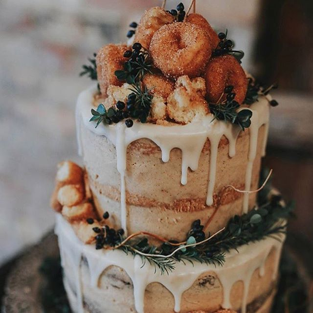 This incredible donut wedding cake is both festive and delicious! We've chosen our Top 10 Holiday Wedding Cakes on our blog! 'Tis the season for yummy and beautiful wedding cakes! Link in profile. Inspiration via @summertaylorphotography @emily_pearblossom . . . #wedding #bohowedding #weddingcake #weddinginspiration #weddingideas #weddinginspo #donuts #cake #yum #holidayseason