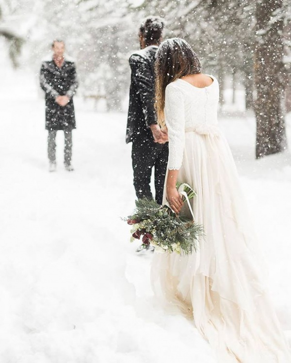 Bride and Groom and Falling Snow