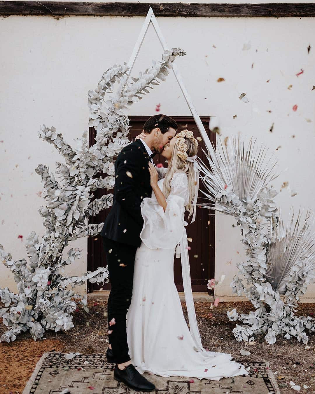 Triangle Wedding Arbour with Couple Kissing