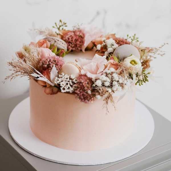 Pink Wedding Cake with Floral Accents