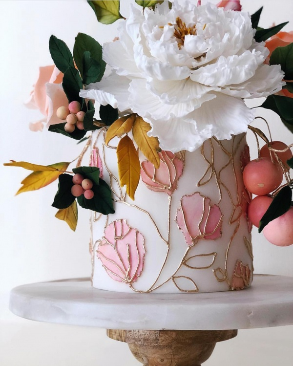 Wedding Cake with Pink and White Flower Accents