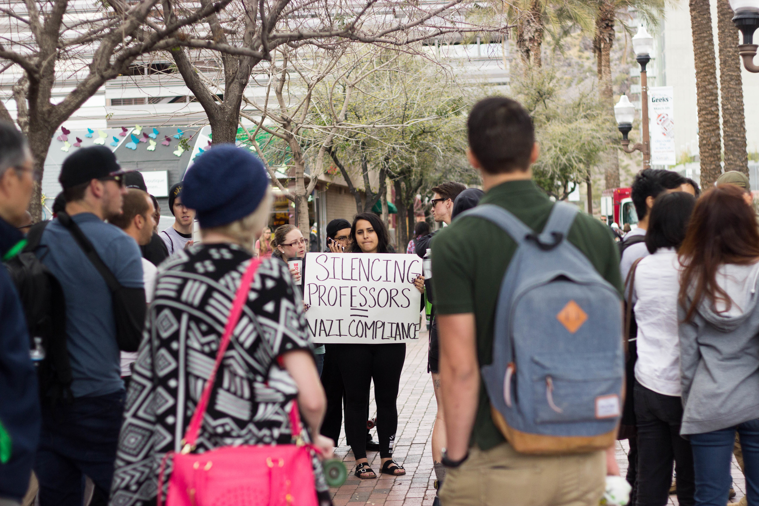 Junior ASU student Vanna Moreles of Tempe, Ariz. stands among a crowd in protest against National Youth Front and ASU's lack of action against the white nationalist group Tuesday afternoon. (Photo by Gretchen Burnton)