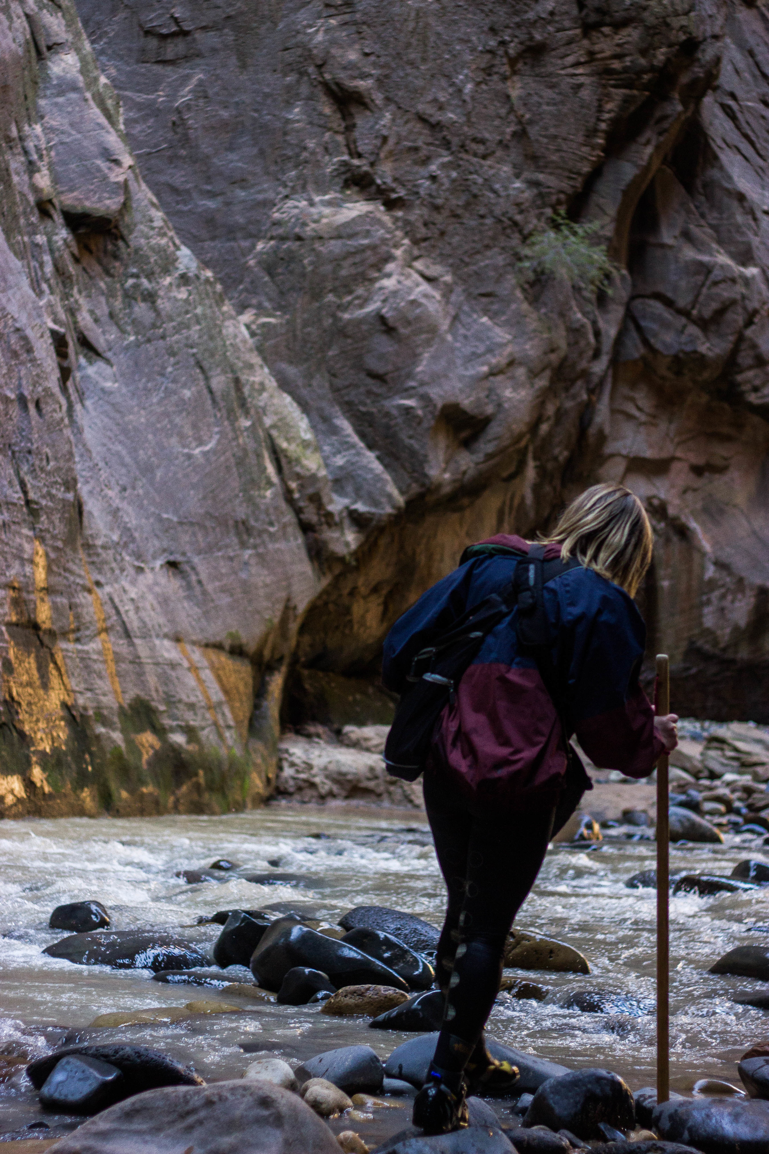 Jessica Obert, 22, of Phoenix, Ariz. hikes the Narrows trail in Zion National Park in Hurricane, Utah. (Photo by Gretchen Burnton)