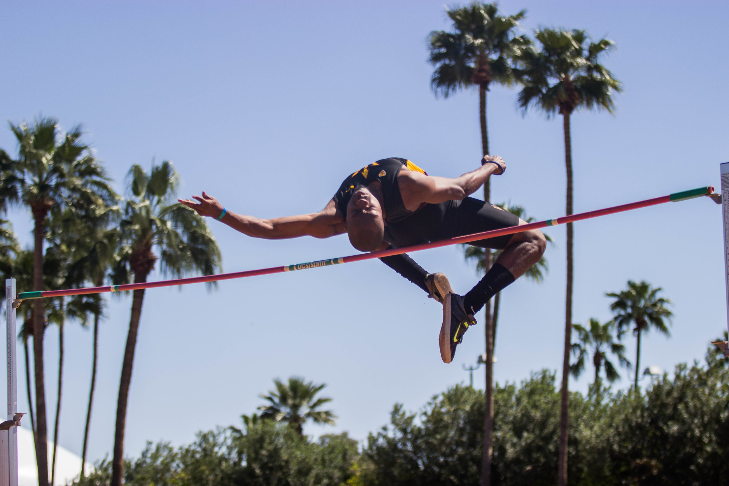 Edmond Baker clears 2.14 m in the high jump. Schools from across the country gathered for the Baldy Castillo Invitational at the Sun Angels Stadium in Tempe, AZ. (Photo by Gretchen Burnton)