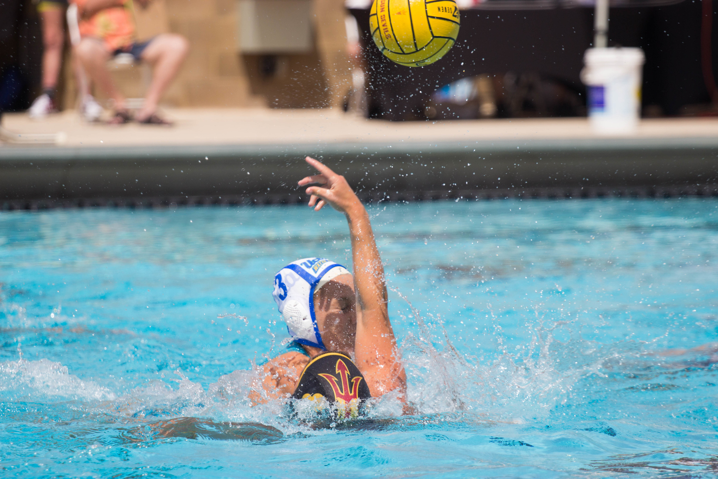 ASU sophomore Alkistis Benekou attempts to keep the ball away from UCLA junior Kodi Hill. The game ended in a score of 11-5, UCLA at the Mona Plummer Aquatic Complex in Tempe, Ariz on Saturday.(Photo by Gretchen Burnton)