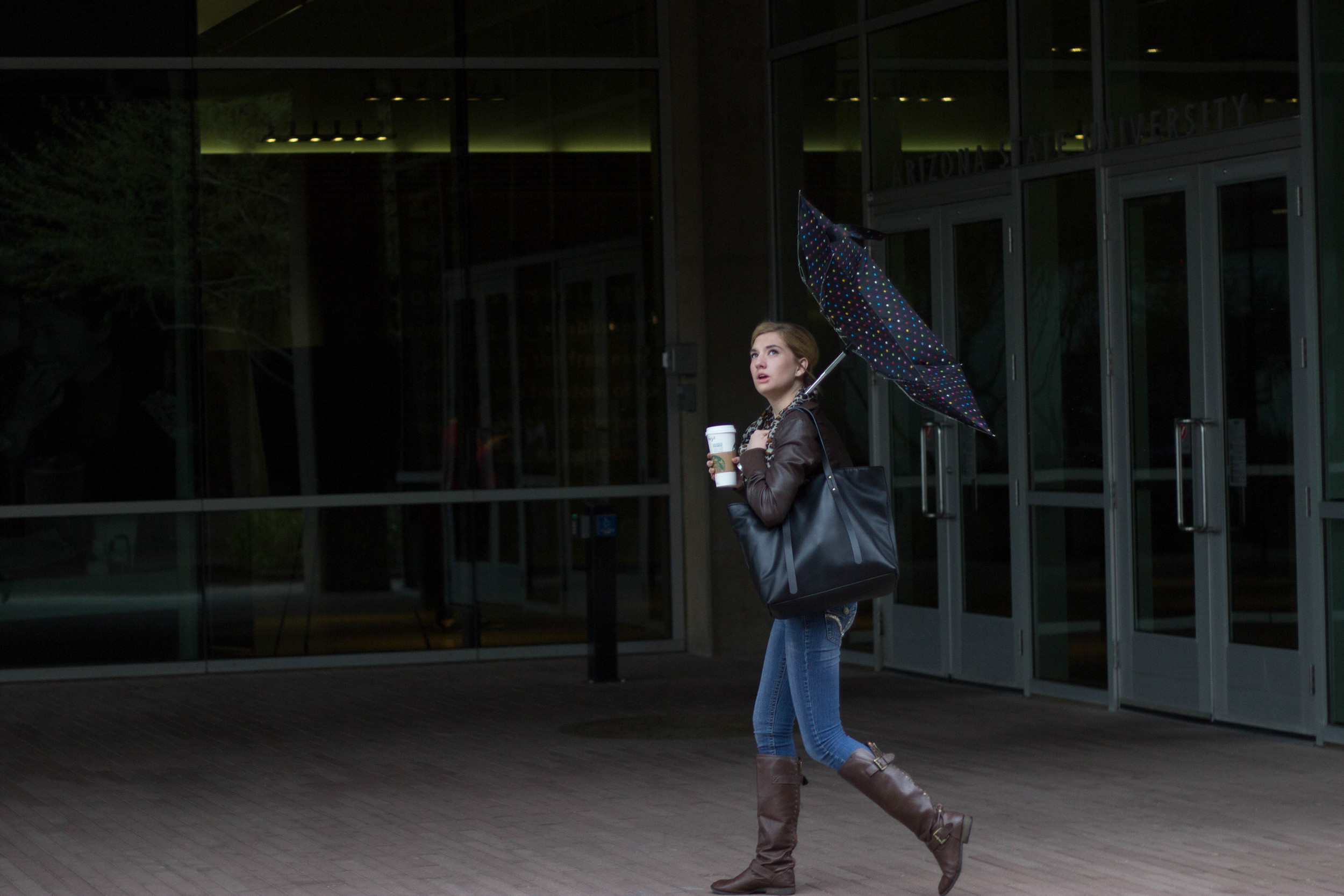 A Cronkite student gets caught in the rain Monday morning in Phoenix, Ariz. (Photo by Gretchen Burnton)
