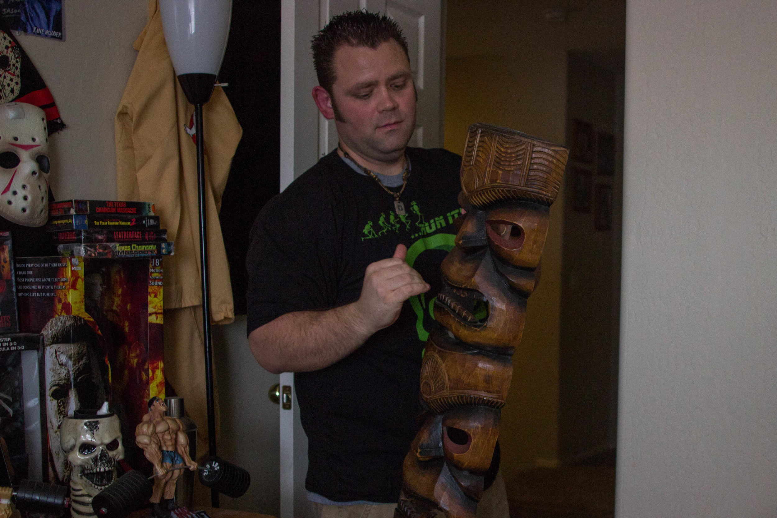 Owner and case manager of Arizona ghost hunting group COPS, Jay Yates of Phoenix, Ariz., removes a totem from his home office that he and his wife believe might be haunted. (Photo by Gretchen Burnton)