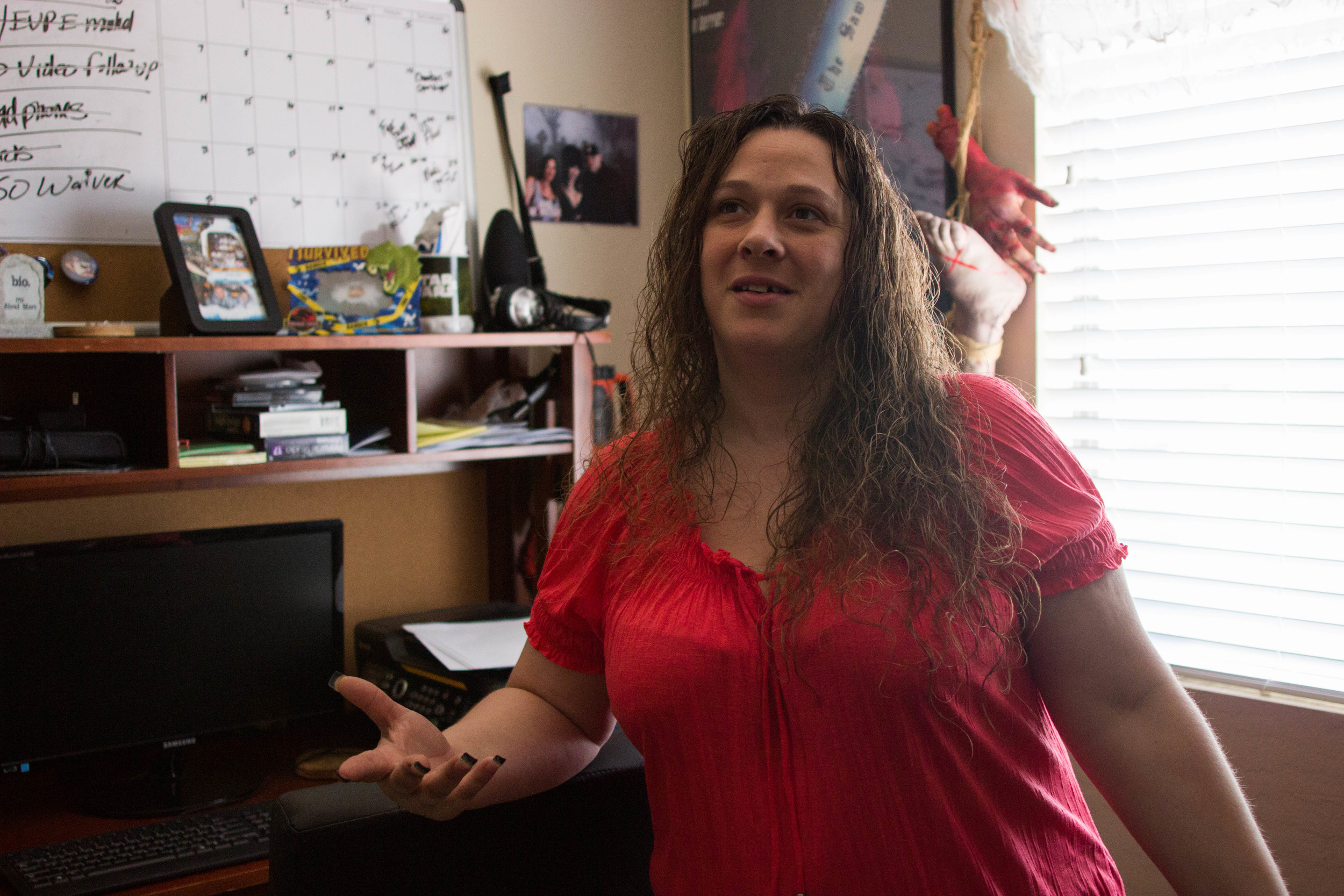 Owner and Public Relations Manager of the COPS Arizona paranormal group Marie Yates of Buckeye, Ariz. stands in her home office where she conducts much of her work as a travel agent in Buckeye, Ariz. (Photo by Gretchen Burnton)