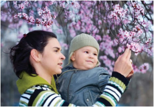 mom and baby with blossoms.jpg