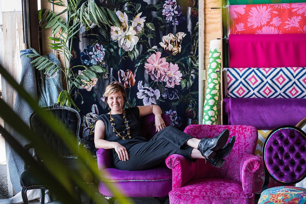 Little & Fox-Portrait of Asha Payton-environmental portait on sofas with colourful fabrics-napier.jpg