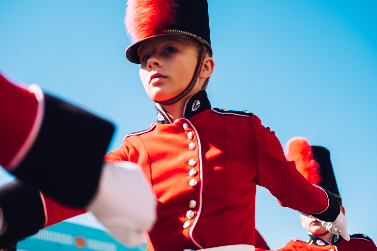 Marching girl at Blossom parade in hastings hawkes bay by photographer florence charvin