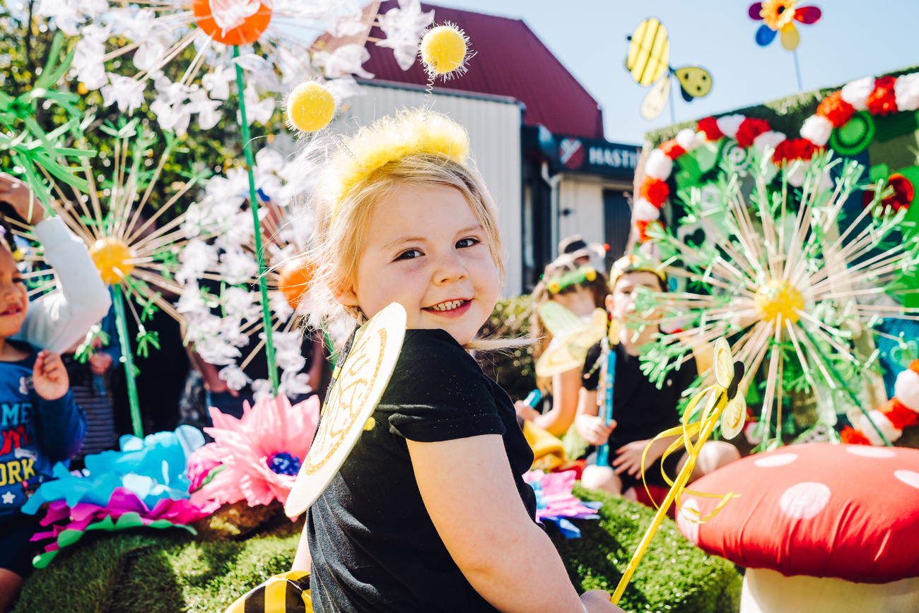 Child on float at Blossom Parade in Hastings Hawkes bay by Florence Charvin
