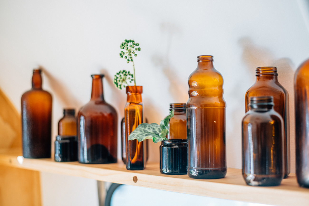 Vintage amber flasks on shelf in caravan shot by commercial photographer Florence Charvin in Hawkes Bay new zealand