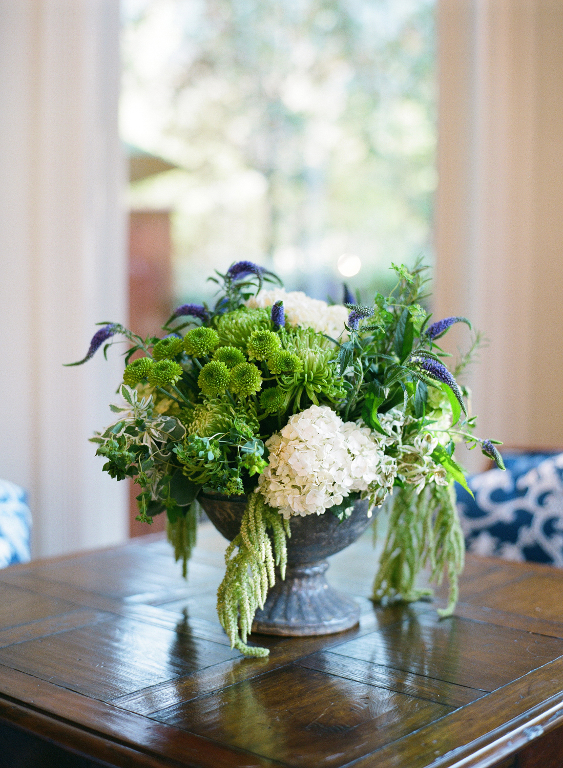Green and white potted flower arrangement