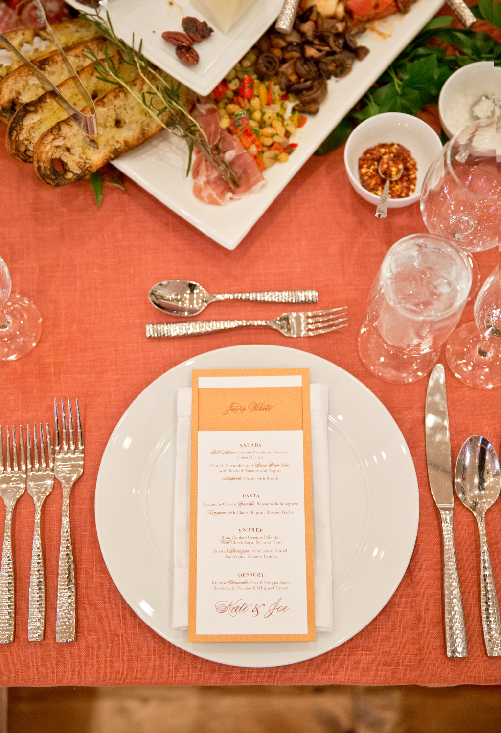 Orange and white dinner place setting