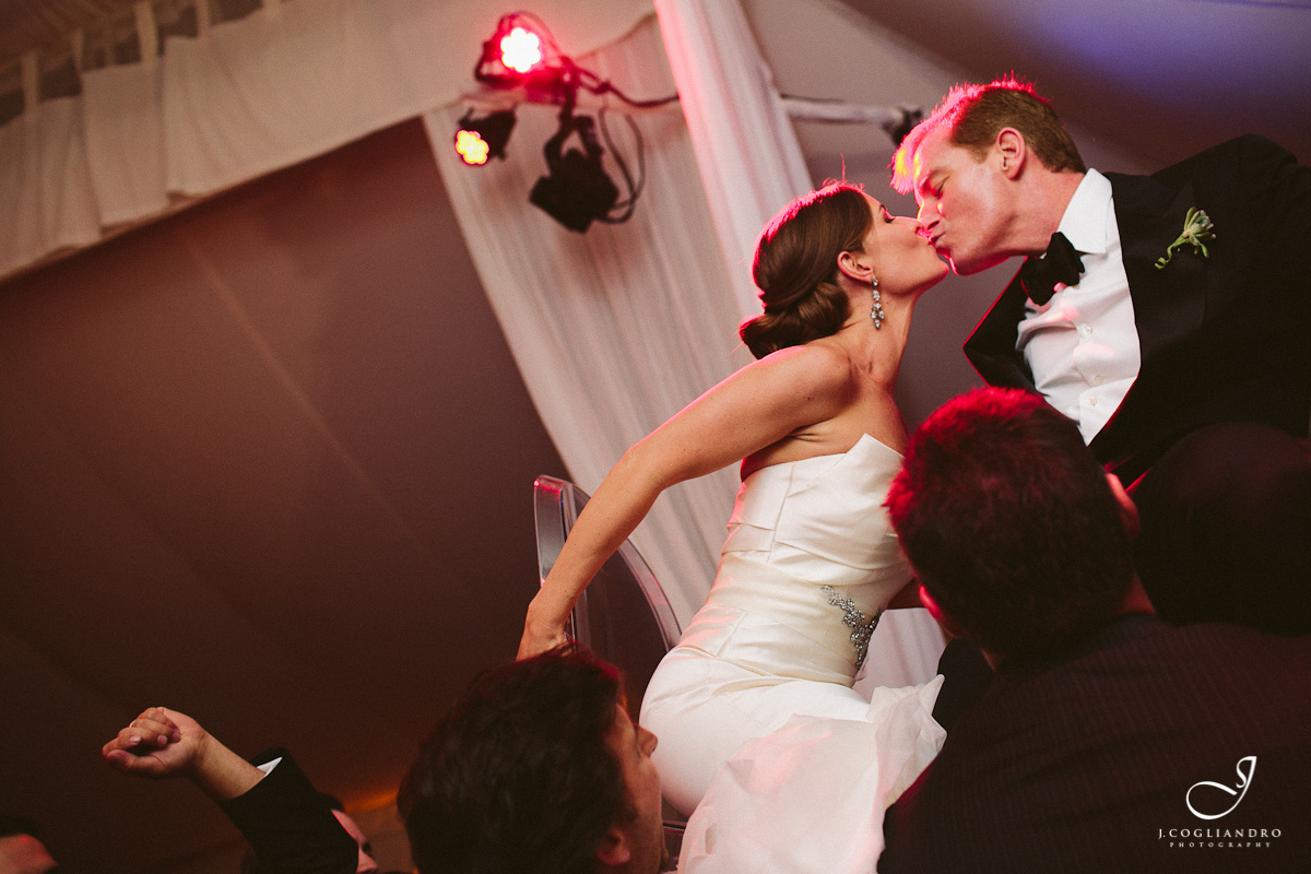 Bride & Groom Kiss While Dancing in Chairs
