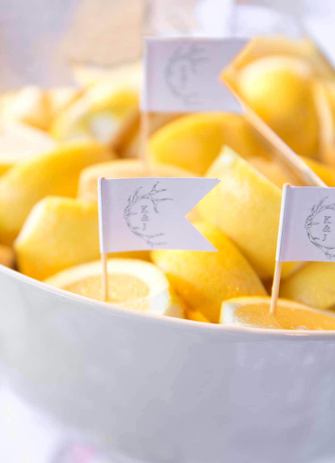 Lemon wedges with monogrammed toothpick flags