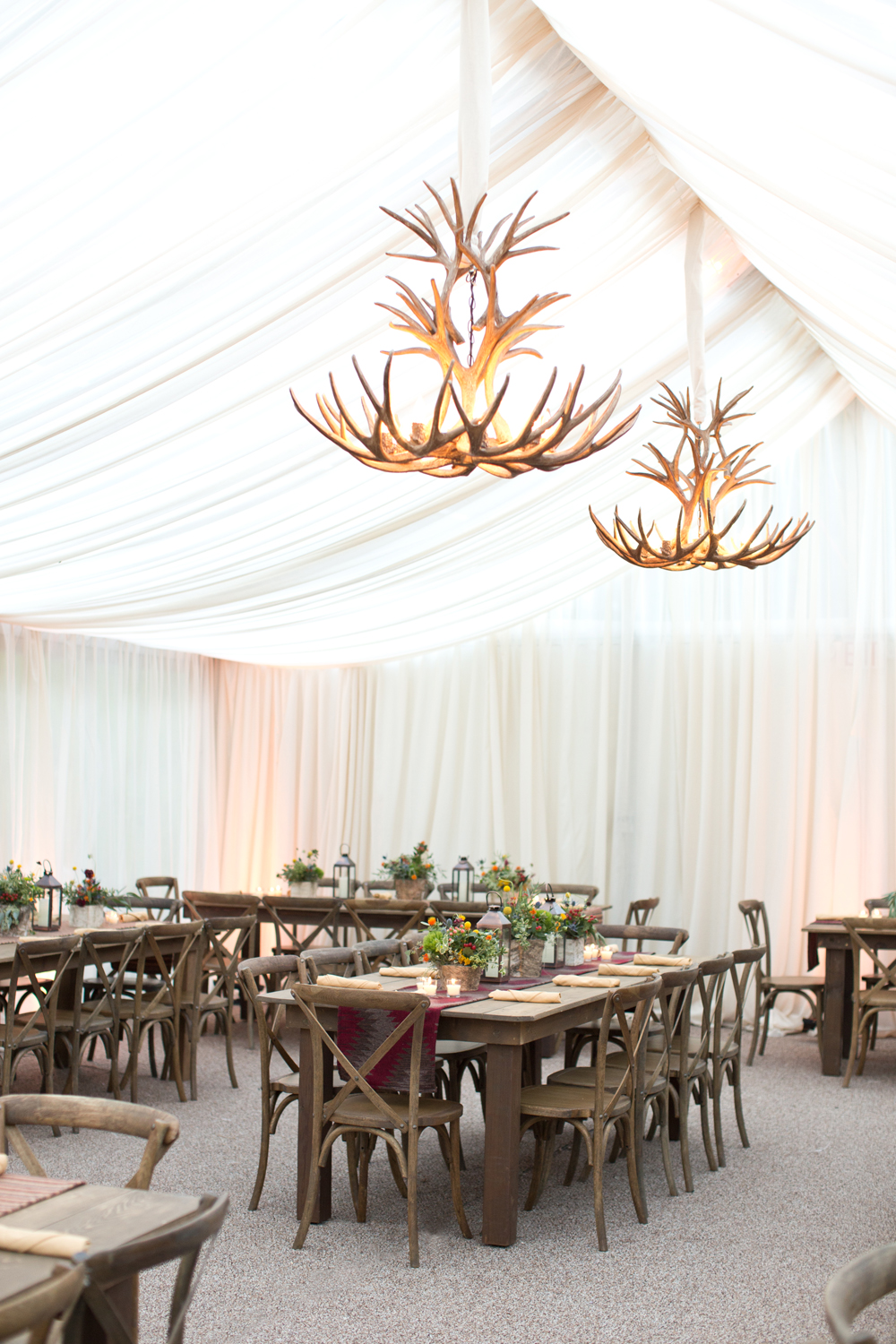 Rustic Dinner Party with Antler Chandeliers and Farm Tables