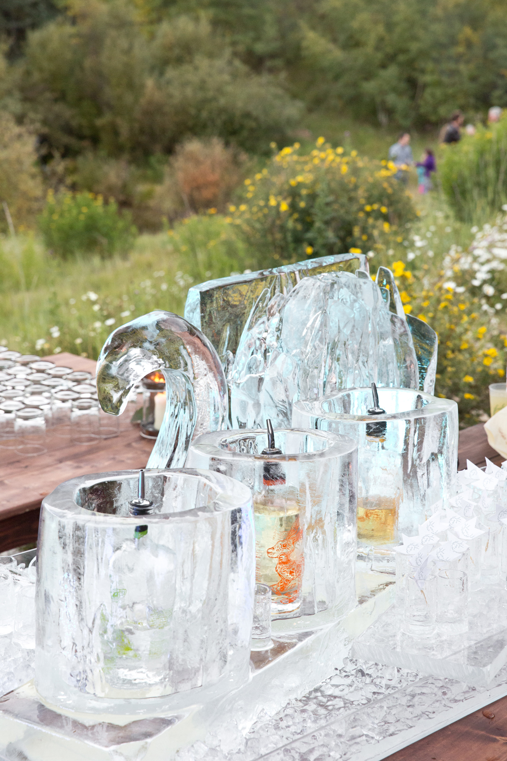 Ice bar with sculpture and ice buckets