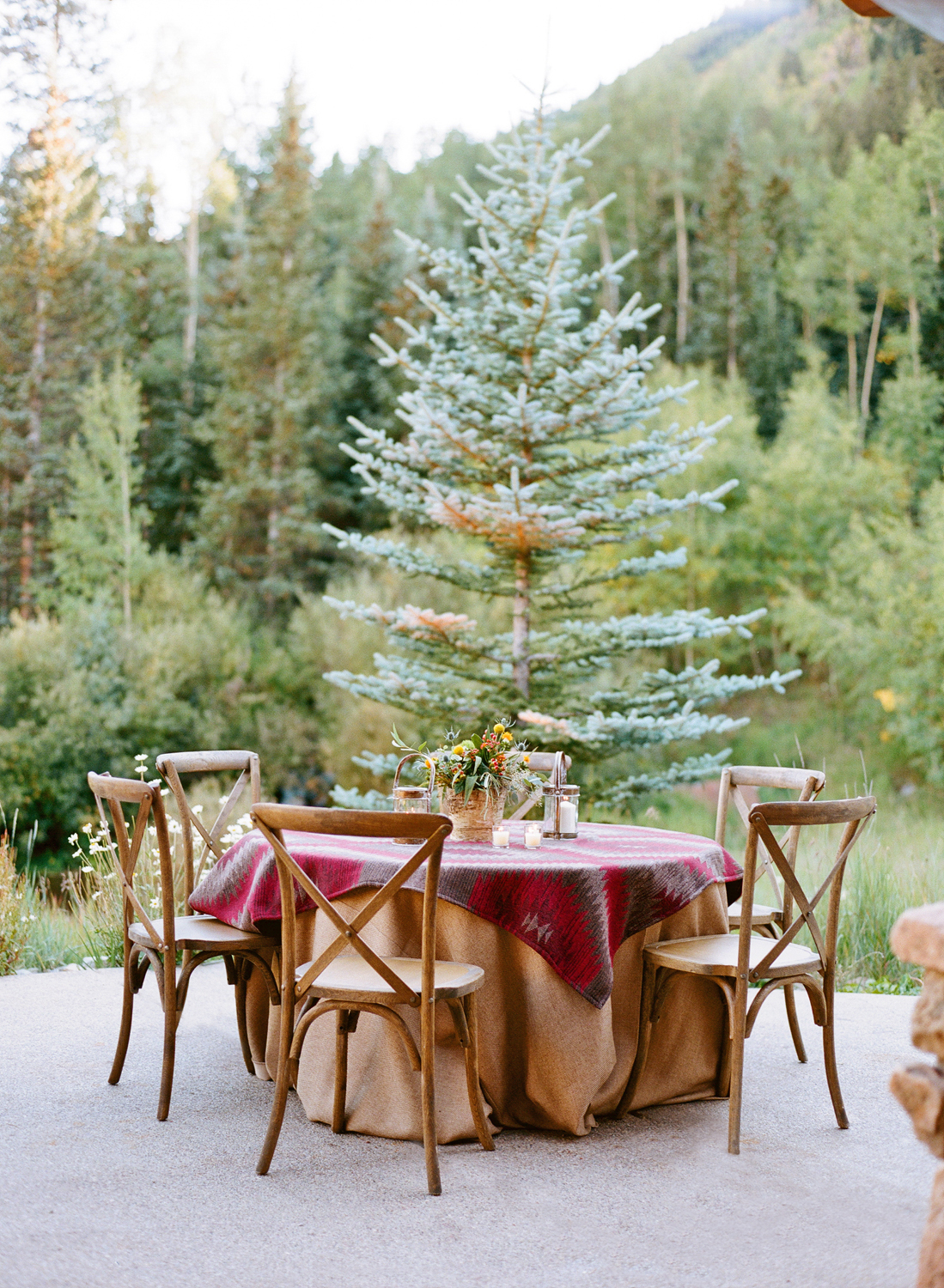 Outdoor farm table with rustic table setting