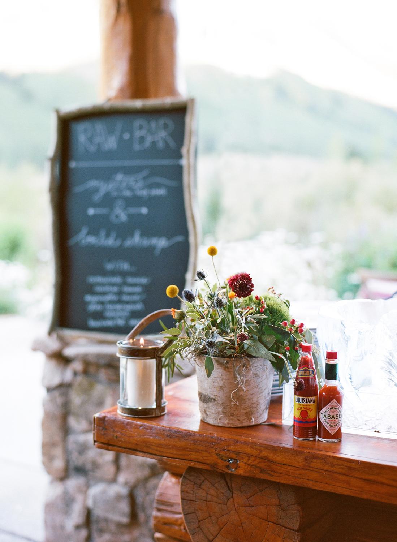 Wood bar with rustic flower arrangement
