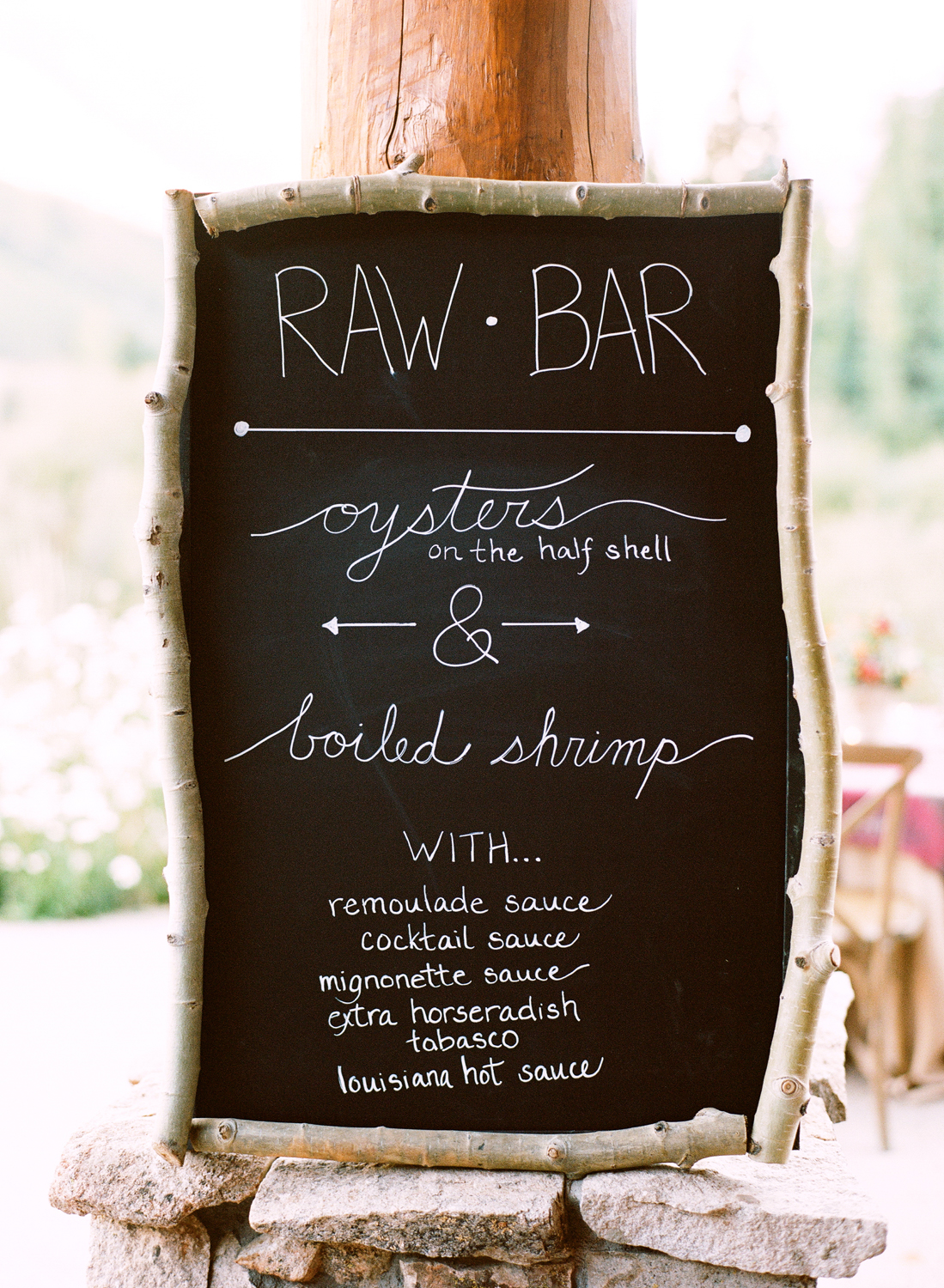 Raw bar chalkboard sign with branch frame