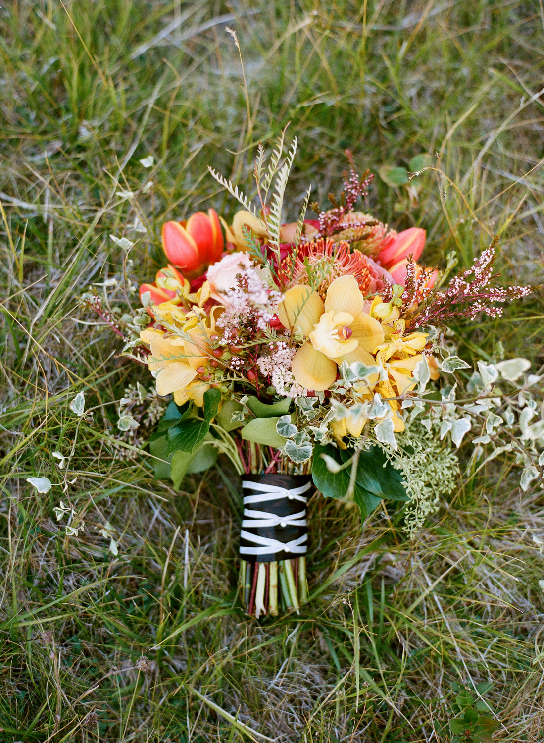 Fall bridal bouquet with red, yellow, green flowers