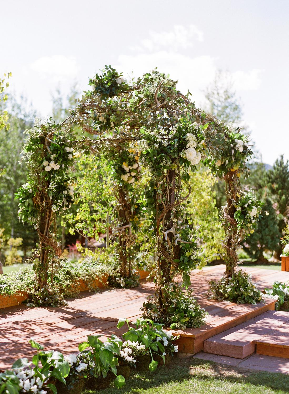 Outdoor wedding arbor made of greenery