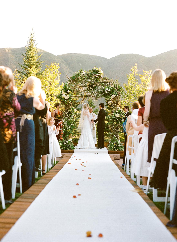 Bride and groom under floral alert