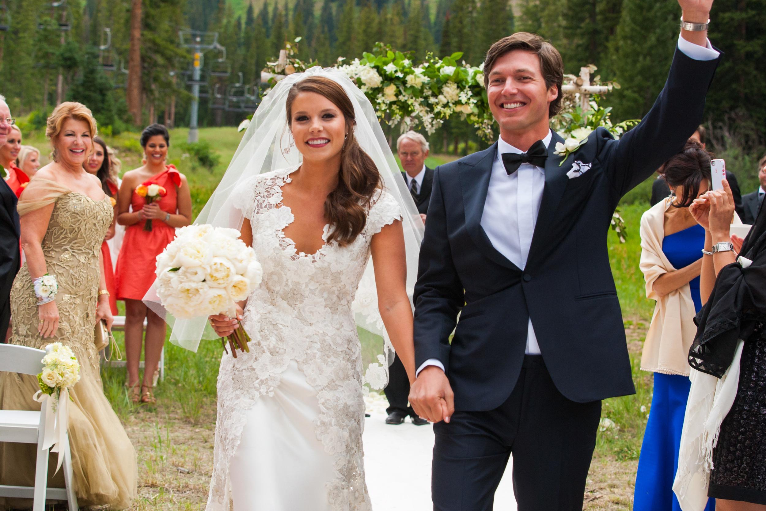 Newlyweds Walking Back Down Aisle