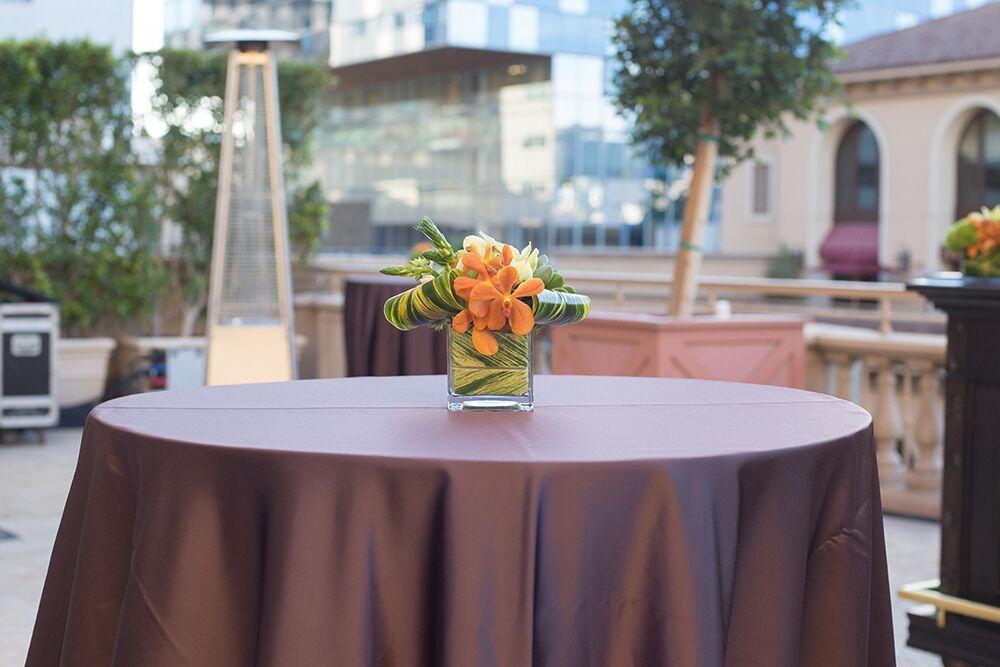 Orange flower cocktail table arrangement