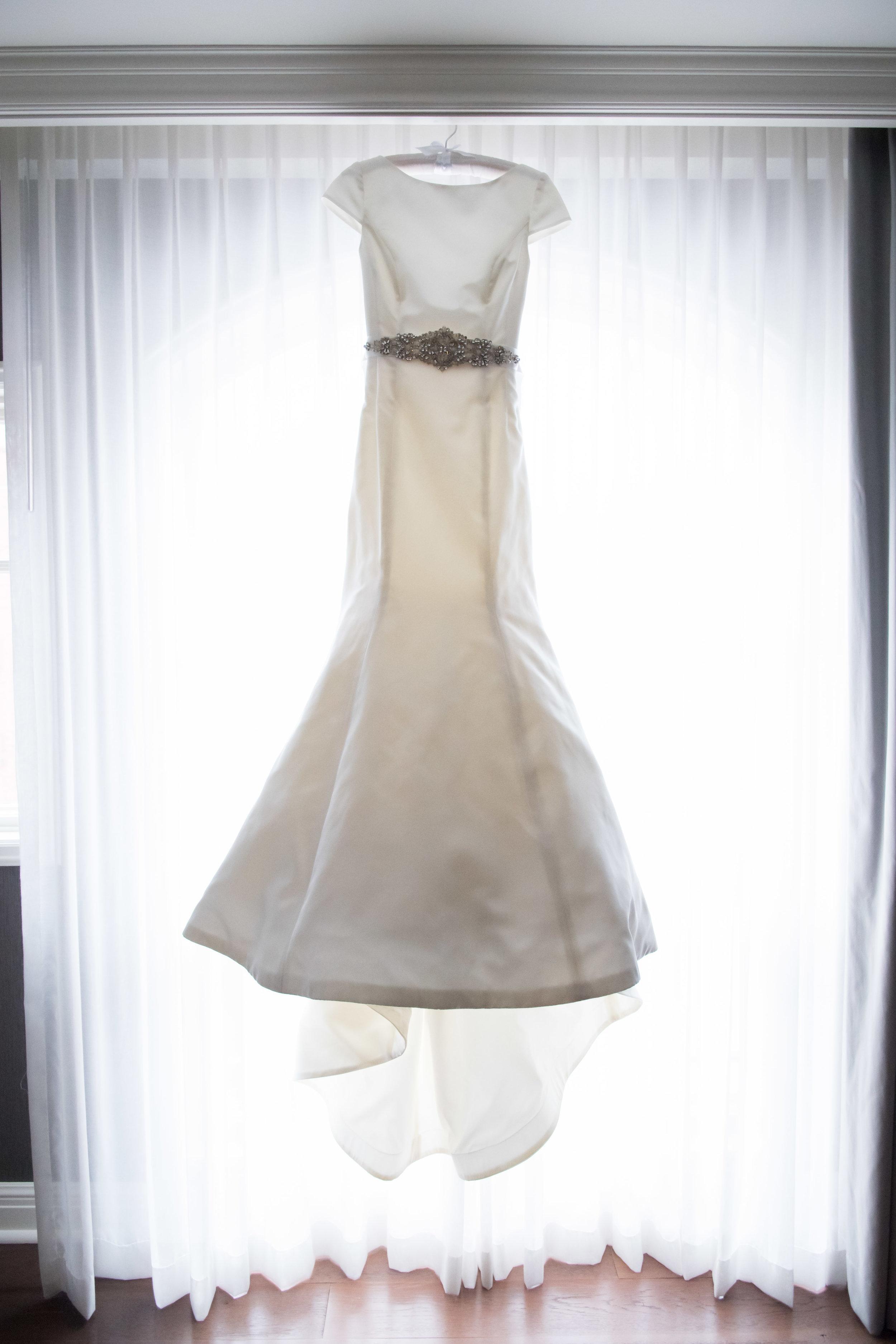 White Wedding Dress Hanging in Window