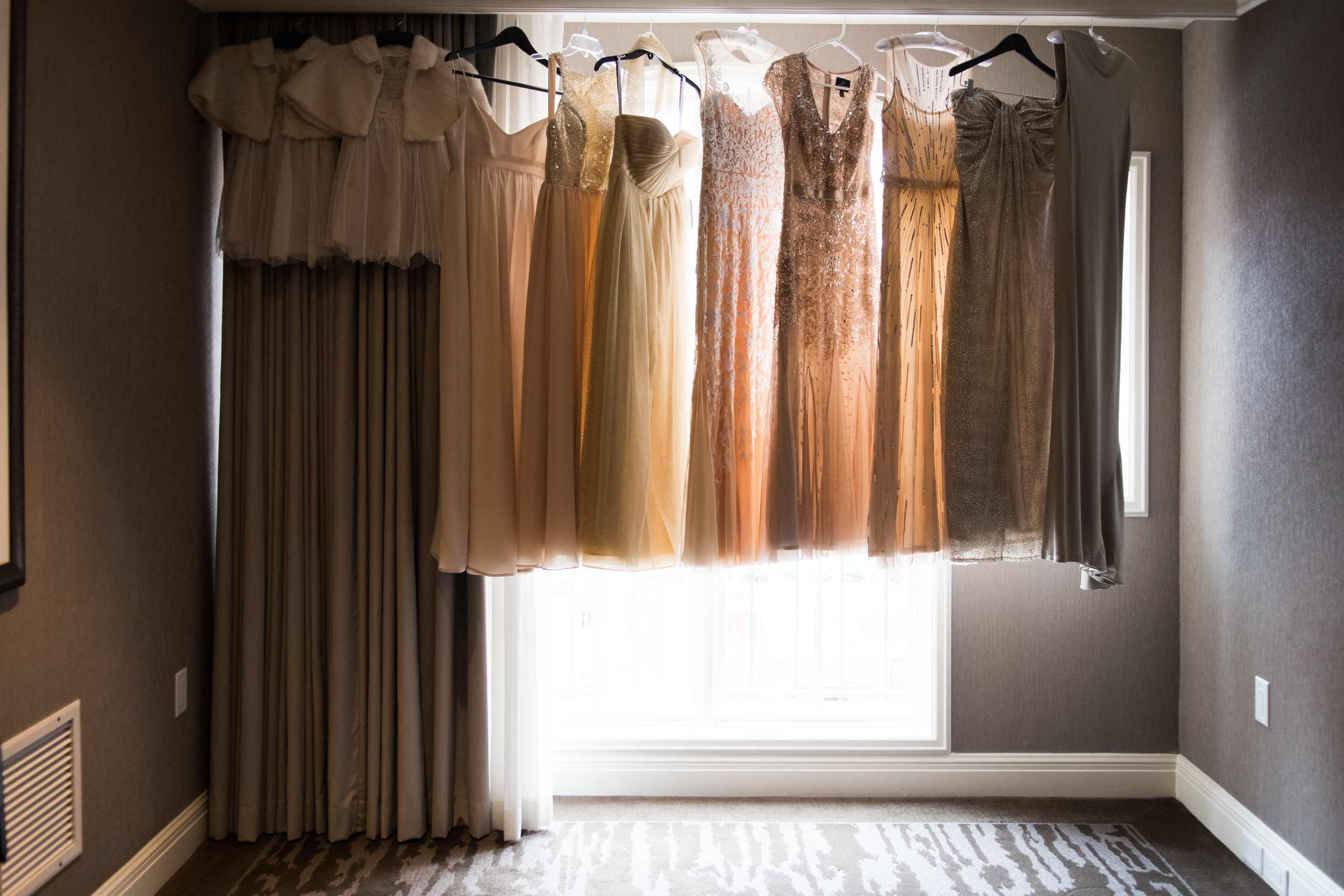 Blush Bridesmaids Dresses Hanging in Window