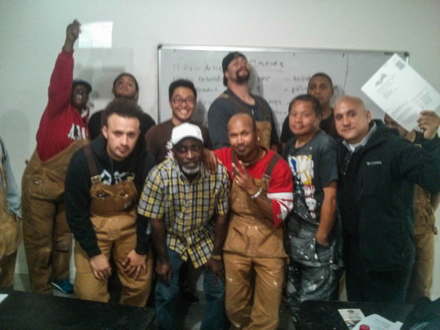 Photo with the team at Asian Neighborhood Design holding their voter registration forms