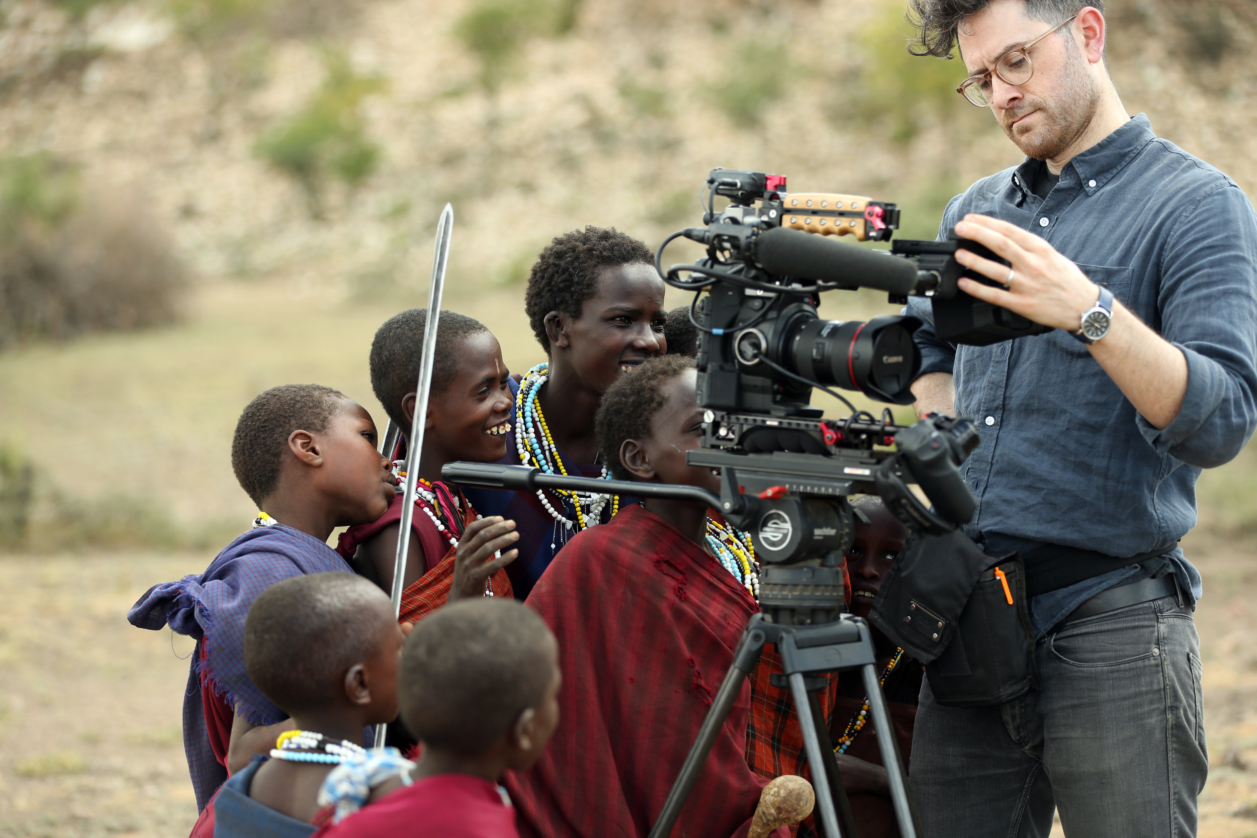 Maasai children check playback between shots in northern Tanzania.